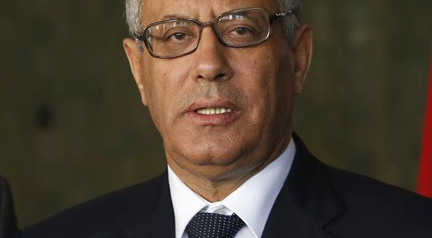 Ali Zidan told a TV station he was advised by allies in the Libyan parliament to leave the country (AP)
