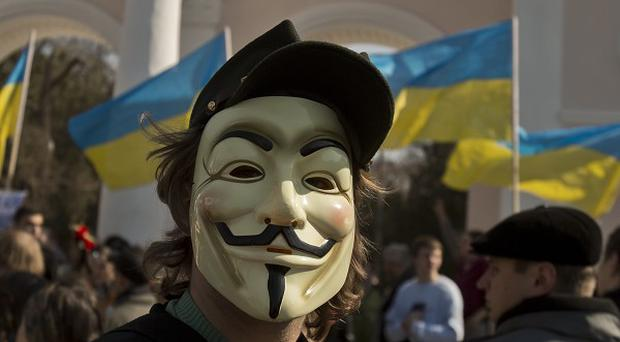 A pro-Ukrainian demonstrator at a rally in Simferopol (AP)