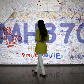 A wall of messages to people involved with the missing Malaysia Airlines jetliner (AP)