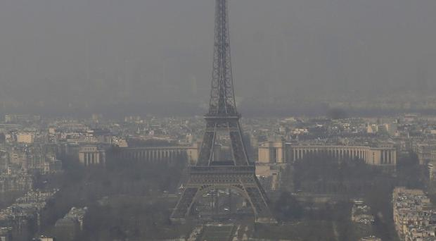 Cars with even-numbered licence plates were prohibited from driving in Paris and its suburbs today, following a government decision over the weekend (AP)