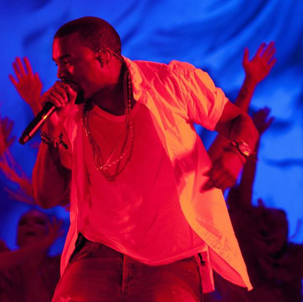 Rapper Kanye West was charged over a scuffle with a photographer at a US airport