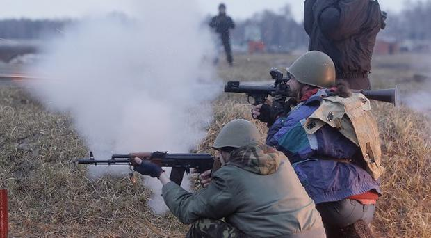 Self-Defence activists perform military exercises at a military training ground near Kiev (AP)