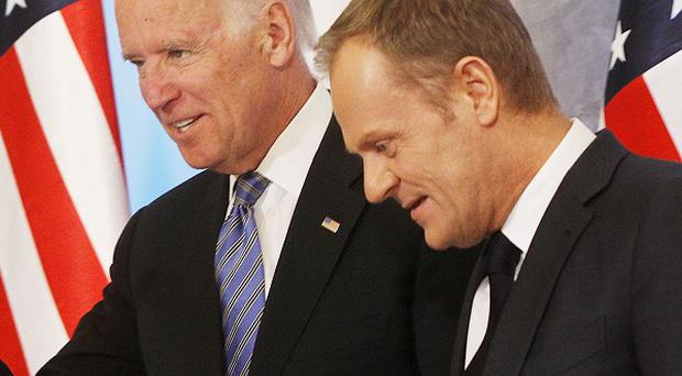US vice president Joe Biden, left, and Poland's prime minister Donald Tusk in Warsaw (AP)