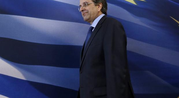 Greece's prime minister Antonis Samaras arrives to make a statement to the media at the Finance Ministry (AP)