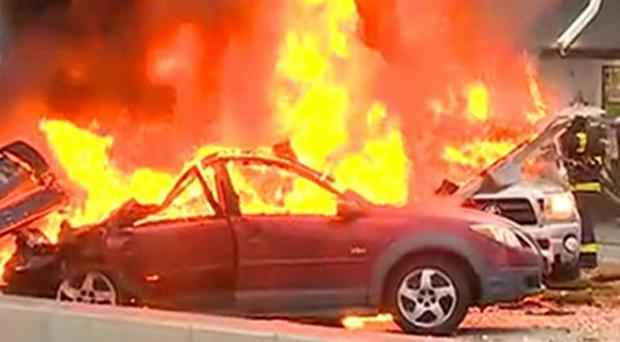 A videograb shows a news helicopter crashed outside TV studios near the space needle in Seattle (AP/KOMO-TV)