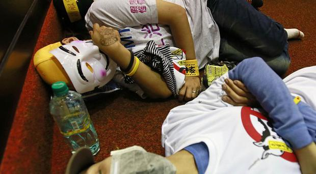 Student protesters against a China-Taiwan trade agreement sleep on the floor of the parliament in Taipei (AP)