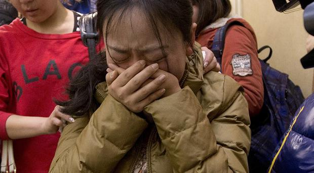 Relatives are still waiting for news on what happened to the missing Malaysian airliner (AP Photo/Andy Wong)