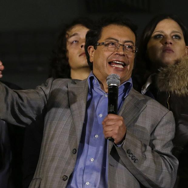 Mayor Gustavo Petro speaks to supporters from a balcony of the city hall in Bogota (AP)