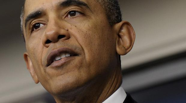 President Barack Obama said the US will do all it can to help the search for the missing plane (AP)