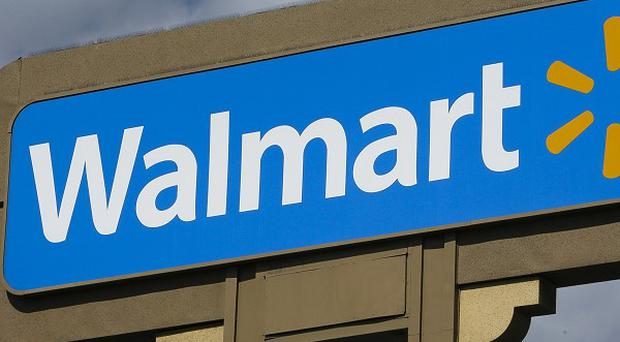Police are hunting a man who tried to suck women's toes at two Wal-Mart stores (AP)