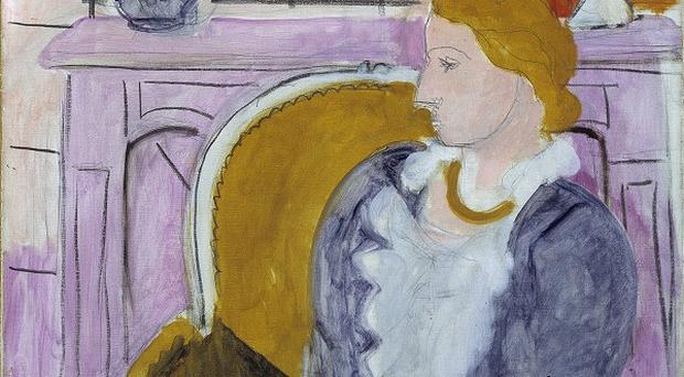 The painting Woman In Blue In Front Of A Fireplace by Henry Matisse was once looted by Hermann Goering (AP/Oystein Thorvaldsen/Henie-Onstad Art Centre)