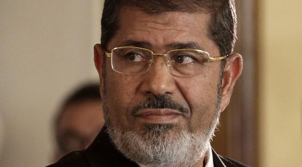 A court in southern Egyptian has convicted 529 supporters of ousted Islamist president Mohammed Morsi to death (AP)