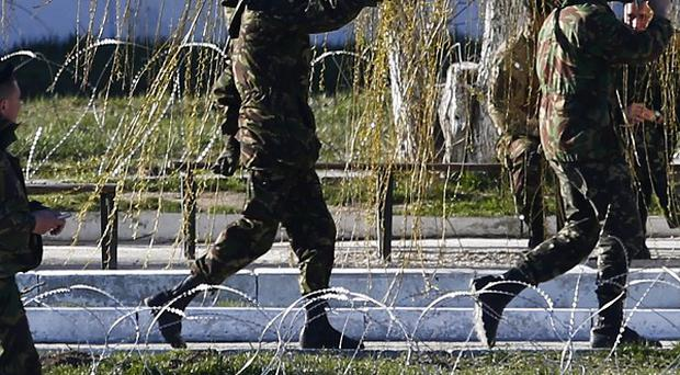 Russian troops seized a marine base in the port of Feodosia (AP)