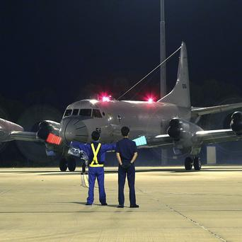 A Japan Maritime Self-Defence Force AP-3C Orion returns to Perth after searching for the missing Malaysia Airlines Flight MH370 (AP)