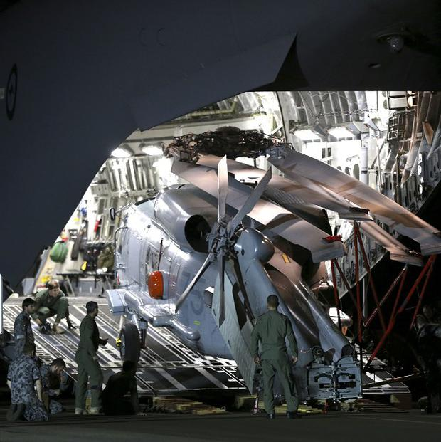 Ground crew unload a Sea Hawk helicopter from a Royal Australia Air Force C-17 at Perth's RAAF Base Pearce to help with the search for Malaysia Airlines Flight MH370 (AP)