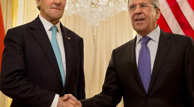 US secretary of state John Kerry, left, shakes hands with Russian Foreign Minister Sergey Lavrov before the start of their meeting to discuss Ukraine, in Paris (AP)