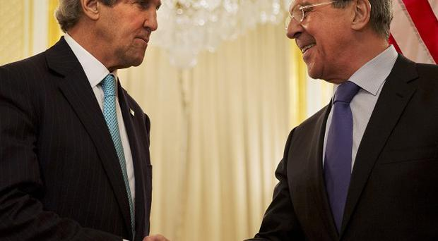 US secretary of state John Kerry, left, and Russian foreign minister Sergey Lavrov at their Paris meeting (AP)
