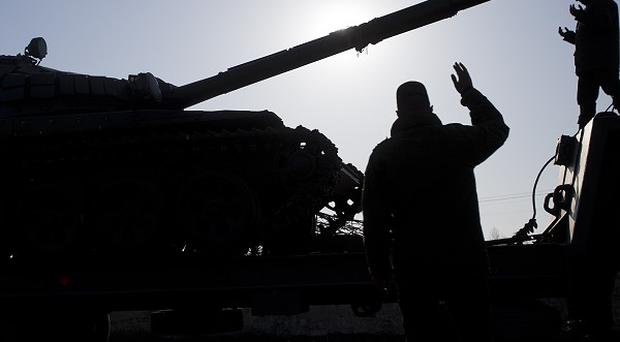 Ukrainian police moved to disarm members of a radical nationalist group after a shooting spree in the capital, Kiev (AP)