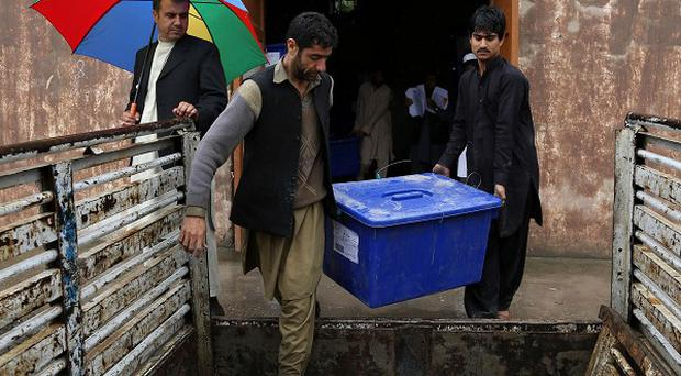 The blast comes after the Taliban repeated a warning to Afghans to stay away from the vote, saying election workers and polling centres would be fair game (AP)