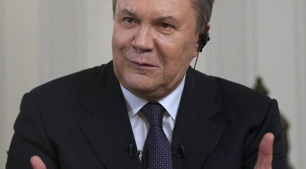 Ousted Ukrainian president Viktor Yanukovych said he still hopes to negotiate with Russian president Vladimir Putin to get Crimea returned to Ukraine