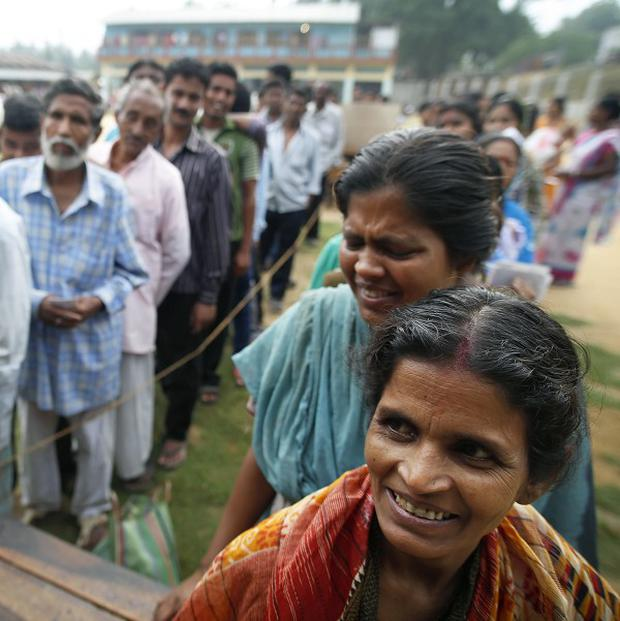 People queuing to cast their votes during the first phase of India's elections (AP)