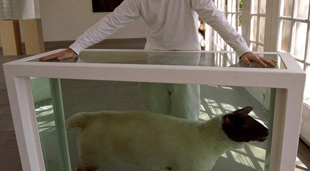 Artist Damien Hirst, with Away From The Flock, a dead lamb suspended in formaldehyde