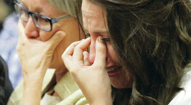 Oscar Pistorius' sister Aimee Pistorius (right) cries as she listens as her brother testify