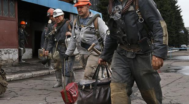 Ukrainian rescuers leave the Skochinsky mine in Donetsk where seven men were killed (AP)