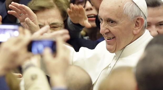 Pope Francis leaves after an audience with students at the Vatican (AP)