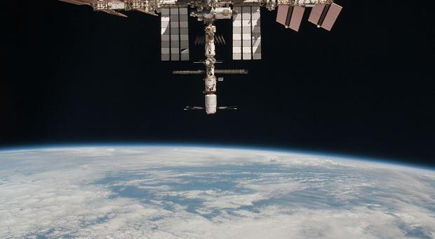 The International Space Station 220 miles above the Earth (Nasa/AP)