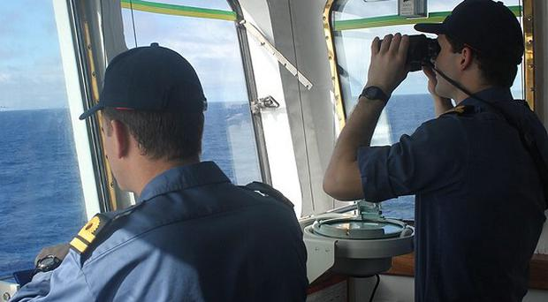 The crew on board survey ship HMS Echo scour the southern Indian Ocean during the search for the flight recorder from the missing Malaysia Airlines flight MH370.