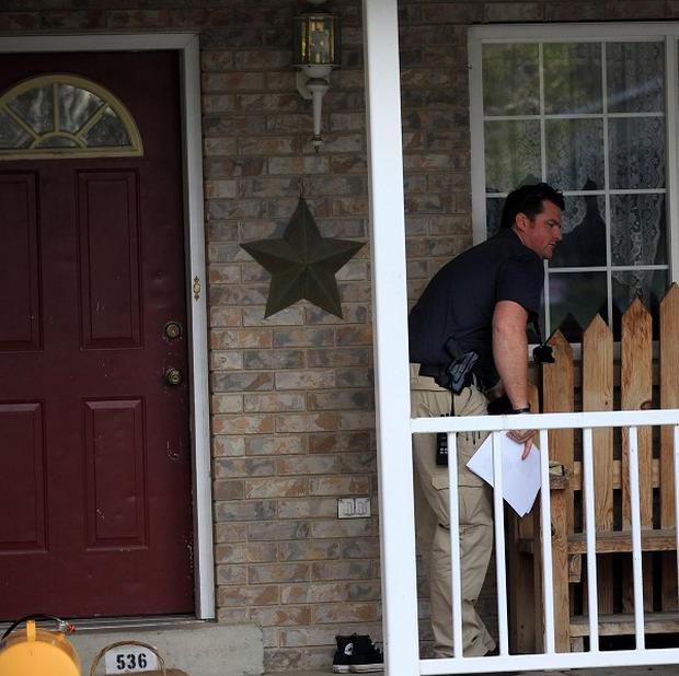 Police at the home in Pleasant Grove, Utah, where seven babies' bodies were discovered (AP)