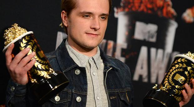 Josh Hutcherson with his best male performance and movie of the year awards for The Hunger Games: Catching Fire (Invision/AP)