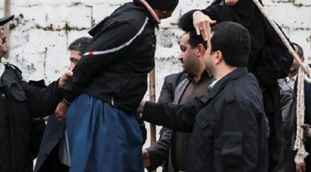 Samereh Alinejad slapped blindfolded Bilal, who was convicted of murdering her son Abdollah, before he was pardoned moments before his planned execution