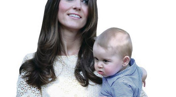 Kate was snapped while taking a stroll with her son in the grounds of Government House