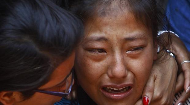 A relative of one of the Nepalese climbers killed in an avalanche on Mount Everest, cries during the funeral ceremony in Katmandu (AP)