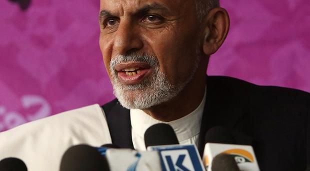 Ashraf Ghani Ahmadzai is in second place in Afghanistan's presidential election, according to partial results (AP Photo/Rahmat Gul)