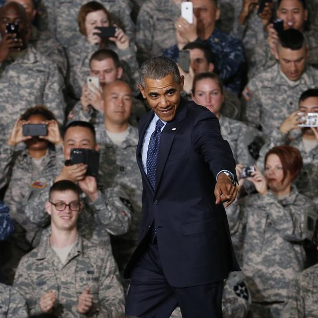Barack Obama meets US military staff at Yongsan Army Garrison in Seoul, South Korea (AP)