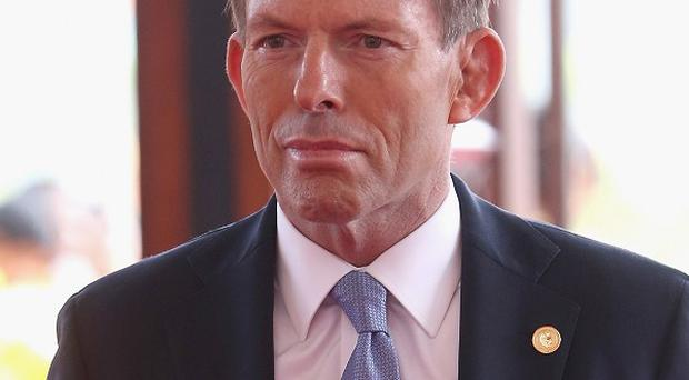 Australia's prime minister Tony Abbott has said the underwater search for the missing Malaysia Airlines plane is to be widened