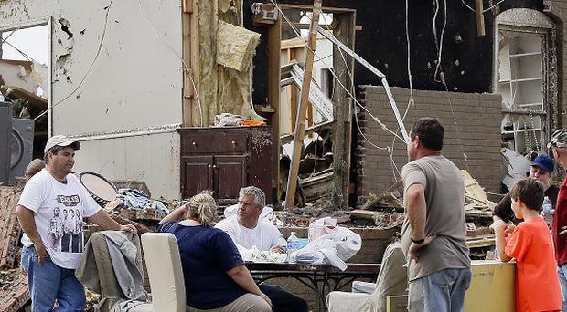 Residents in Fayetteville, Tennessee, take a break from the clean-up after devastating tornadoes (AP)