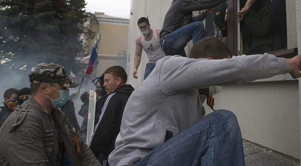 Pro-Russian activists storm an administration building in the centre of Luhansk, Ukraine (AP)