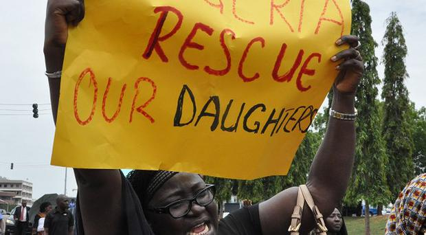 A mother during a demonstration with others who have daughters among the kidnapped school girls of Chibok school (AP)