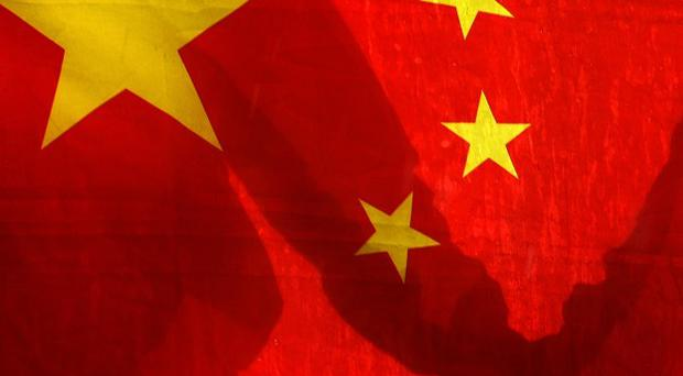 China says terrorists attacked a station in the far-west