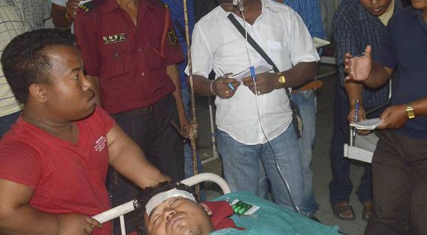 A man injured in an attack receives treatment at a hospital in Kokrajhar (AP)