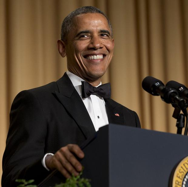 President Barack Obama smiles while making a joke during his speech at the White House Correspondents' Association Dinner (AP)