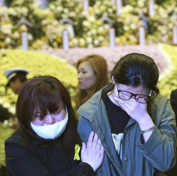 Relatives of passengers pay tribute to the victims at a memorial in Ansan, South Korea (AP)
