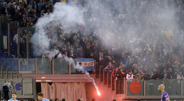 Clashes broke out before the Italian Cup final including a shooting outside the ground (AP Photo/Gregorio Borgia)