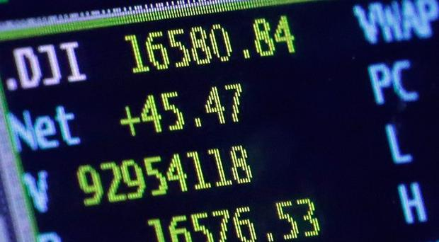 The Dow Jones industrial average climbed 117.52 points, or 0.7%, to 16,518.54 (AP)