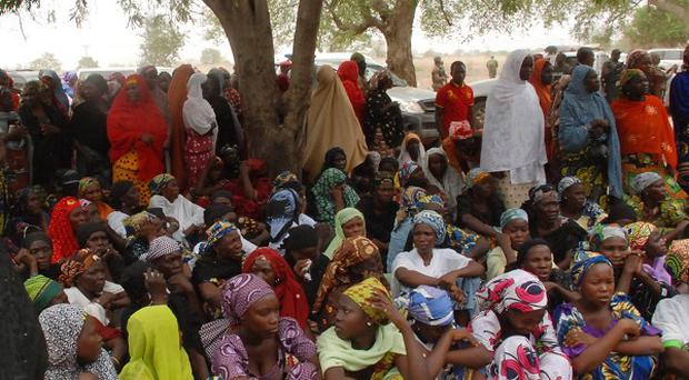 Mothers and some of the kidnapped school girls from the government secondary school Chibok, who managed to escape (AP)