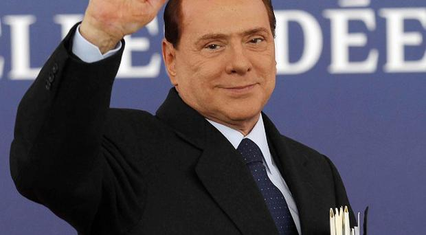 A minister from Silvio Berlusconi's last government has been arrested for allegedly helping a businessman convicted of Mafia links